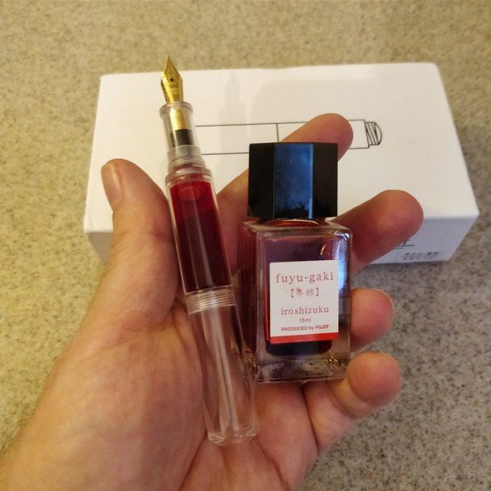 Moonman Wancai fountain pen with bottle of Iroshizuku Fuyu-gaki ink