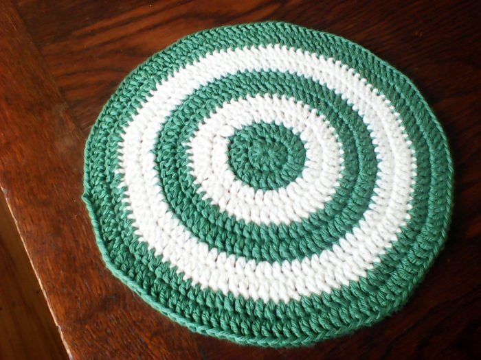 green and white striped circular dishcloth