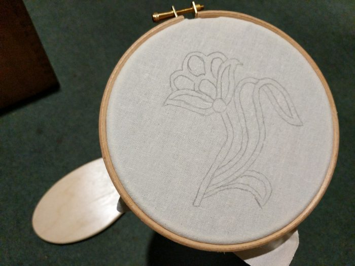 traced pattern on fabric in hoop