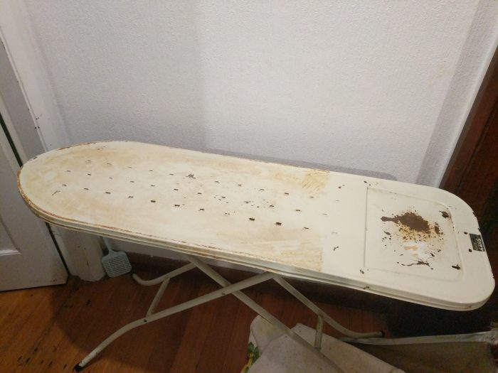 metal ironing board without padding or cover