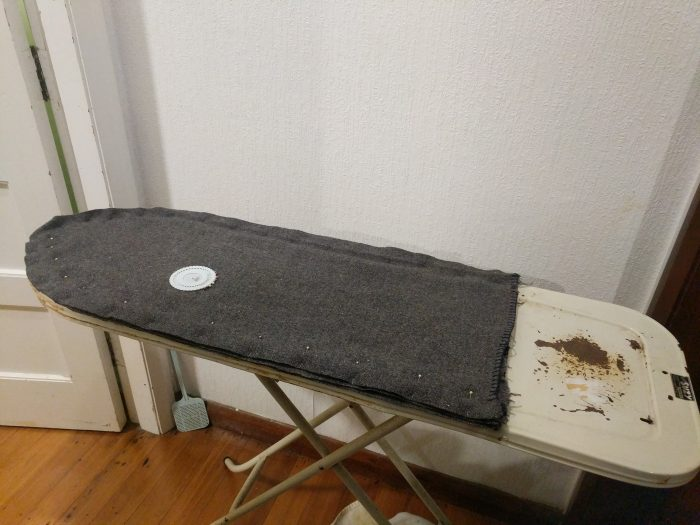 layers of blanket pinned together on ironing board