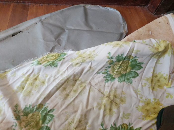 worn and soiled ironing board covers and padding